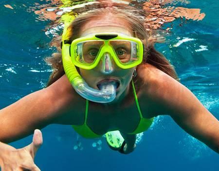 Little Girl Snorkeling in the Reefs of Kauai | Oceanfront Rentals on Kauai