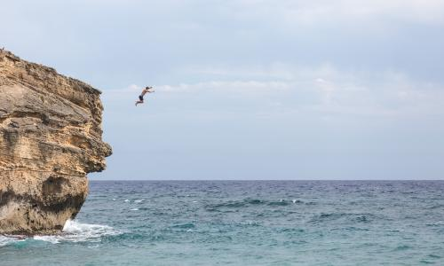 Shipwreck beach cliff jumper